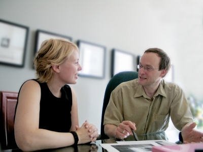 two-people-talking-at-desk What are Strategic Interviews?